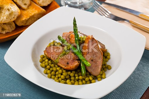 Grilled duck breast with asparagus and green peas