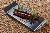 Grilled Eel with Sauce served on a black tile plate The best food of Japan