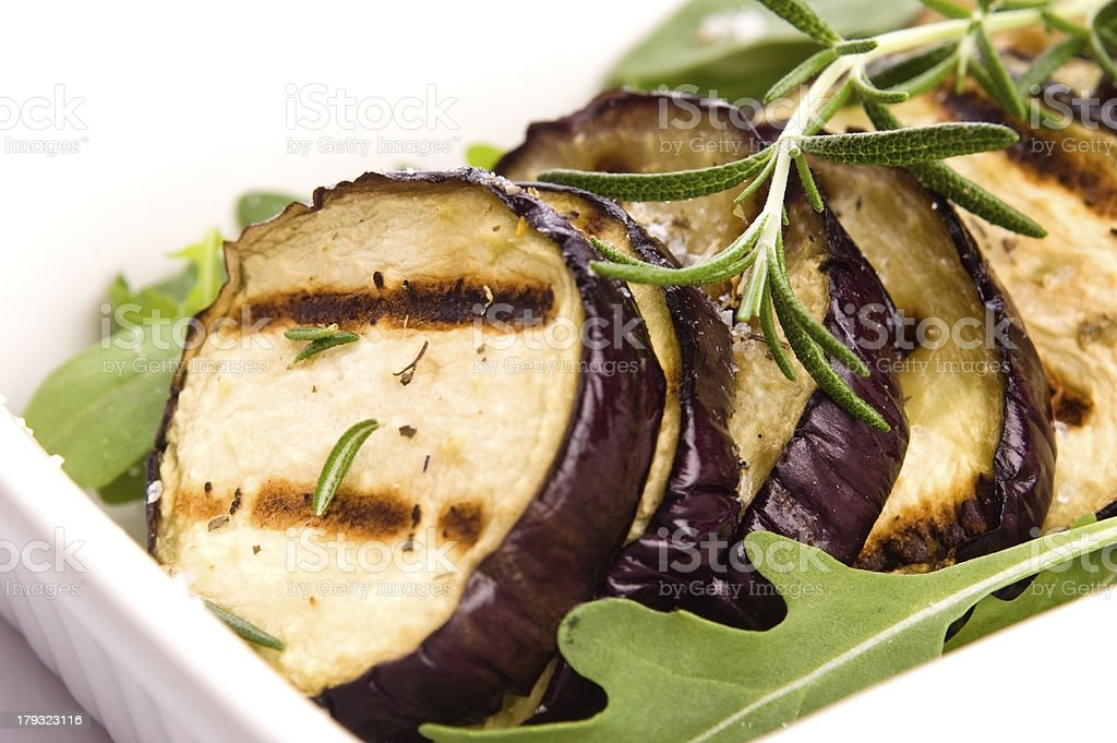 Grilled eggplant slices on a plate with fresh rosemary royalty-free stock photo