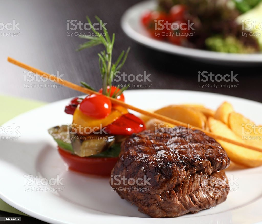 Grilled filet with vegetables on plate royalty-free stock photo