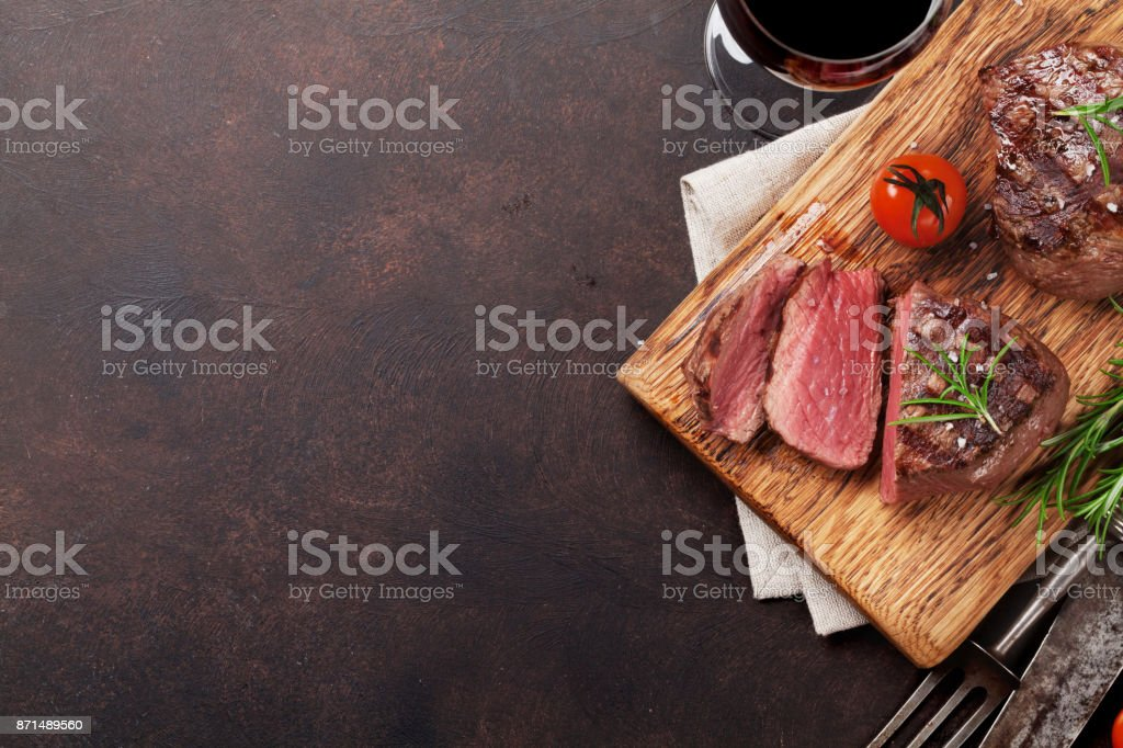 Grilled fillet steak with wine royalty-free stock photo