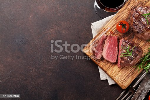808351132 istock photo Grilled fillet steak with wine 871489560