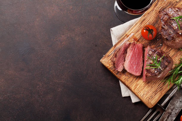 Grilled fillet steak with wine stock photo