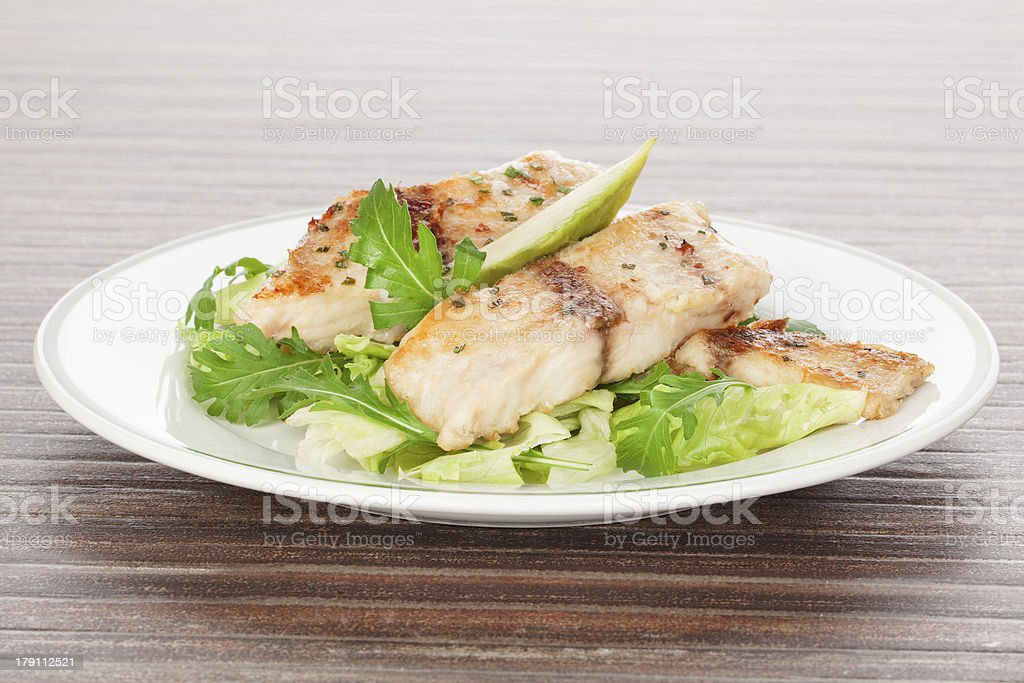 Grilled fish and fresh salad. royalty-free stock photo