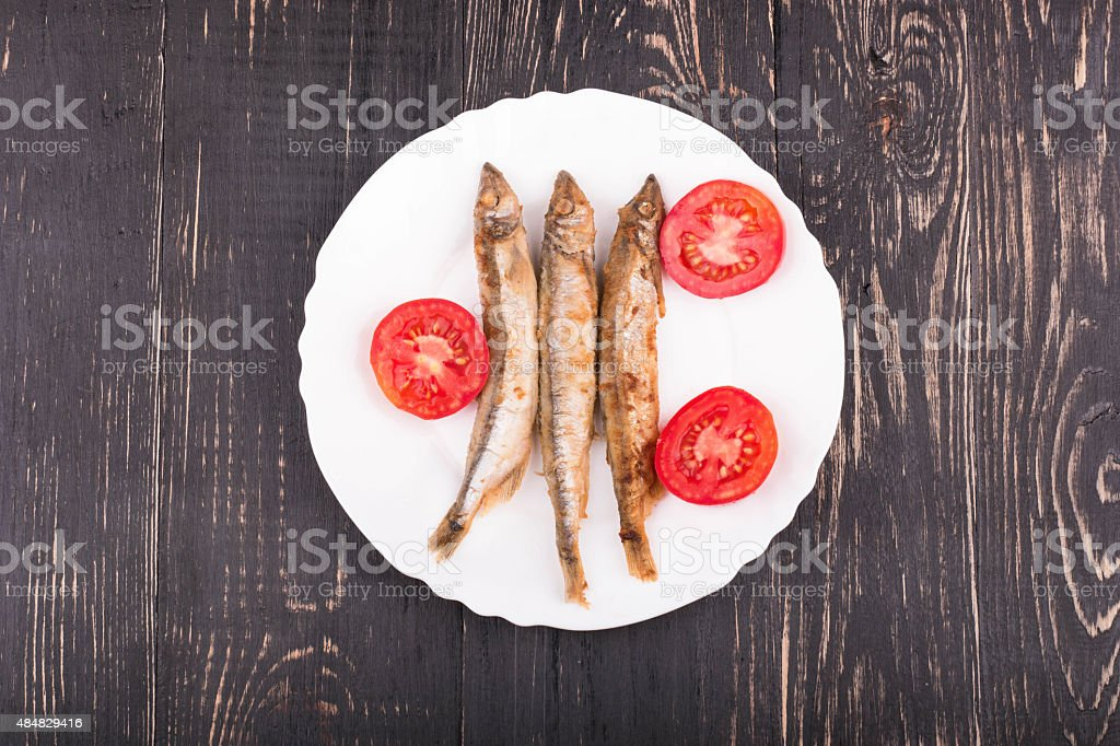 Grilled fish capelin stock photo
