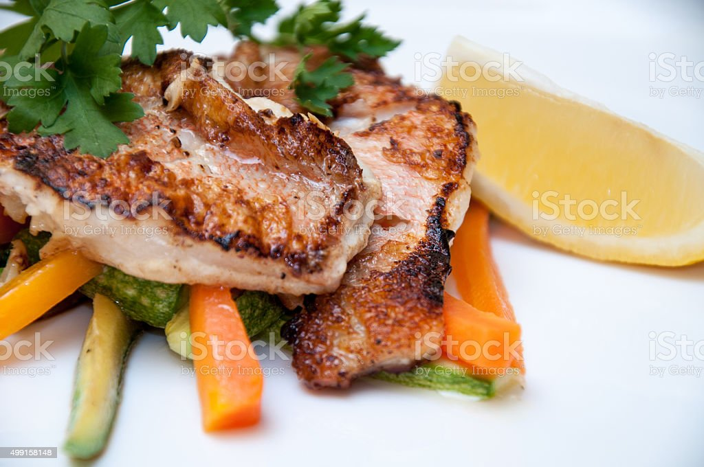 Grilled Fish Fillet and Salad stock photo