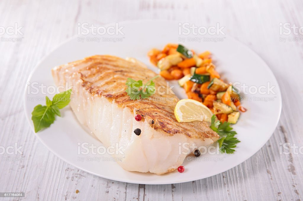 grilled fish fillet and vegetable stock photo