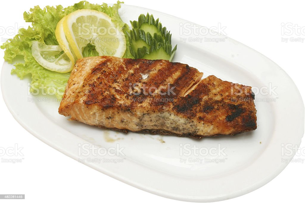Grilled fish fillet on barbecue with salad royalty-free stock photo