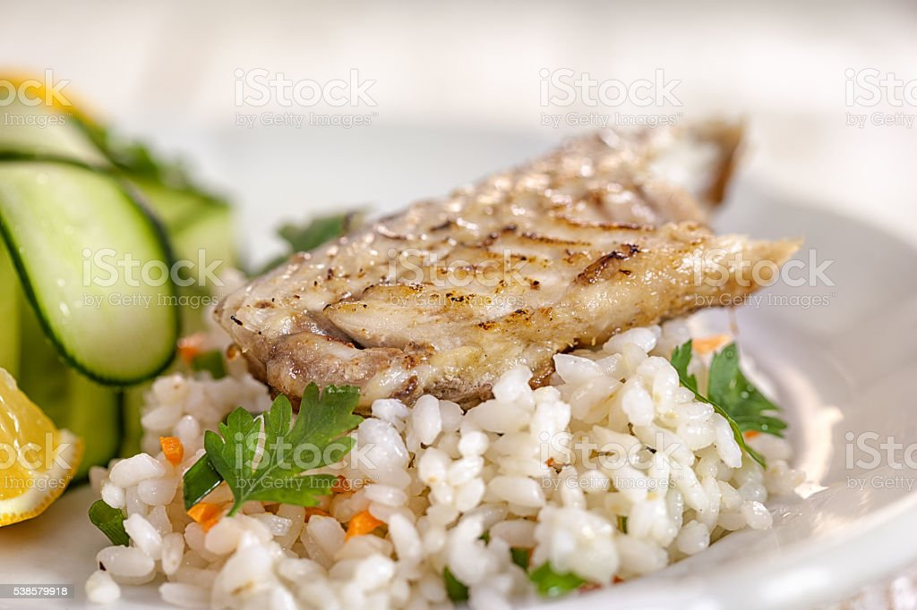 Grilled fish fillet on risotto stock photo