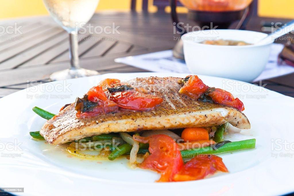 Grilled Fish Fillet on Vegetables stock photo