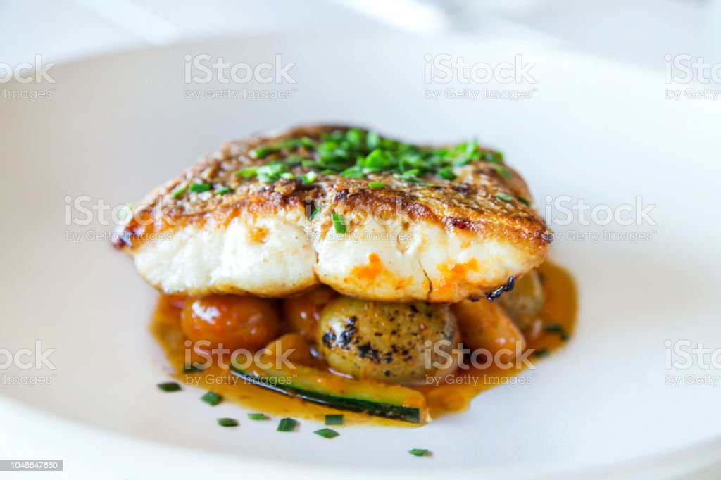 Grilles fish fillet with vegetables stock photo