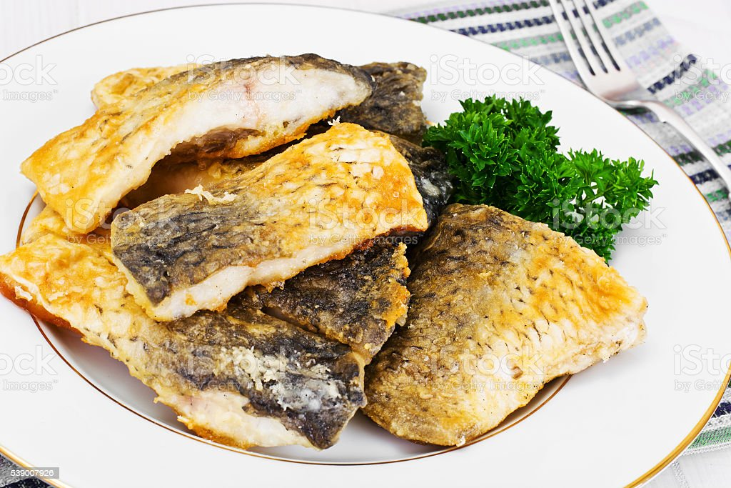 Grilled Fish on White Plate stock photo