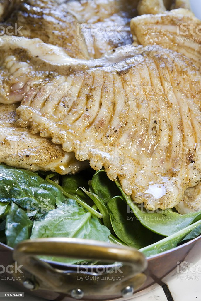 Grilled fish (skate) royalty-free stock photo