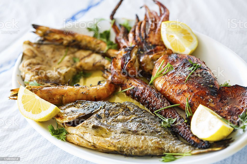 Grilled fish plate royalty-free stock photo