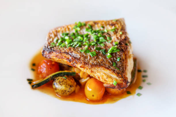 Grilled fish with fresh vegetables stock photo