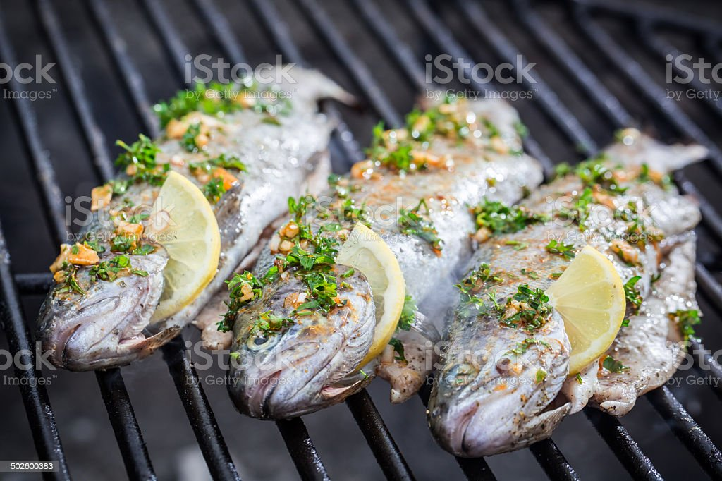 Grilled fish with lemon and spices stock photo