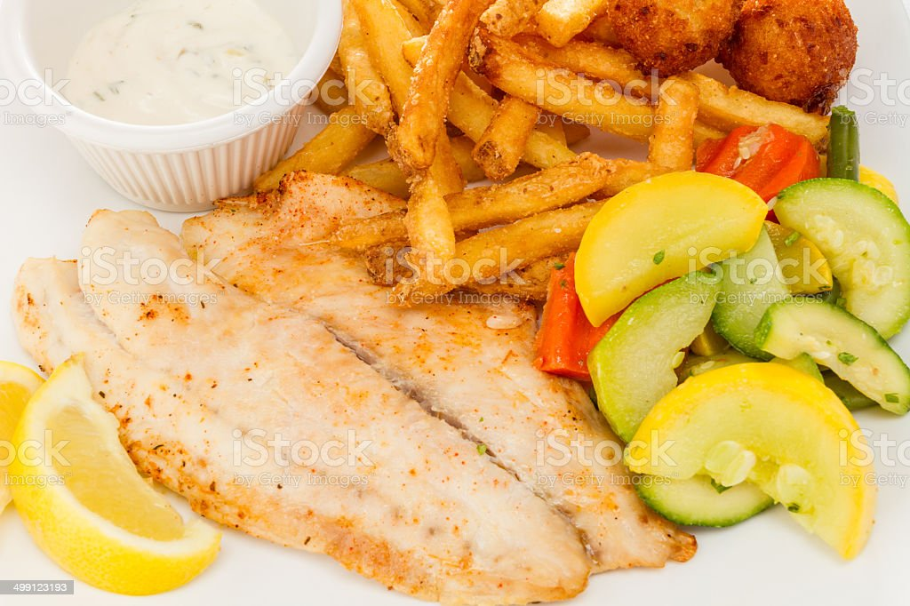 Grilled fish with vegetables and fries. stock photo