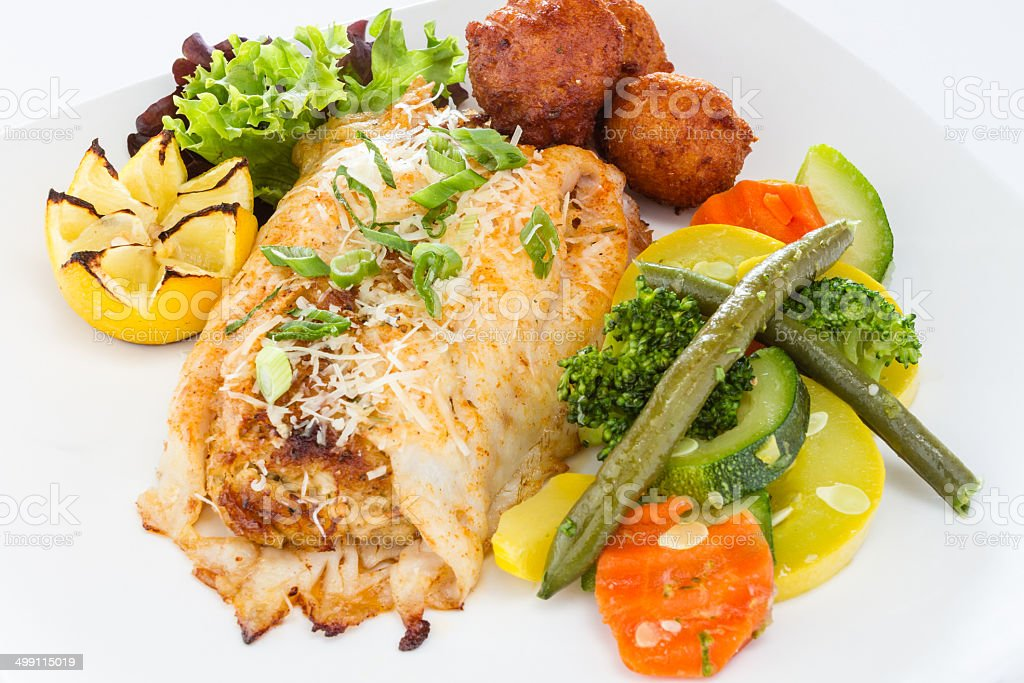 Grilled fish with vegetables. stock photo