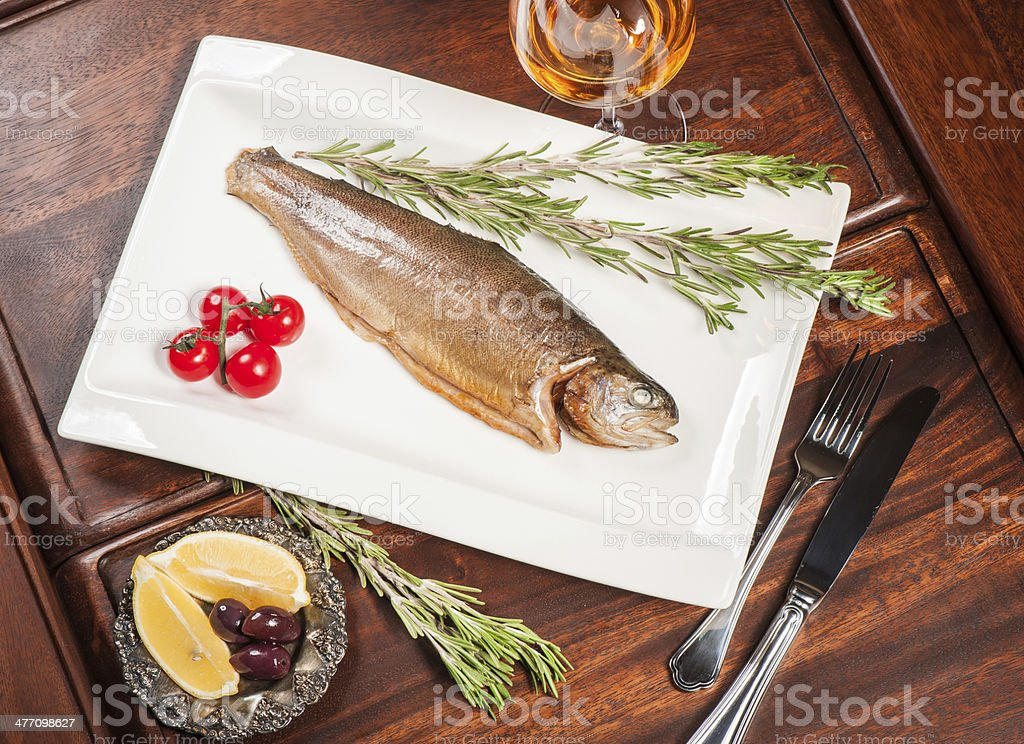 Grilled fish with white wine royalty-free stock photo