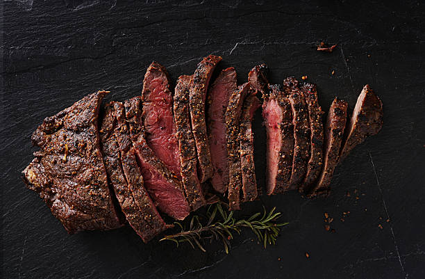 grilled flat iron steak shot in flat lay style - foto de stock