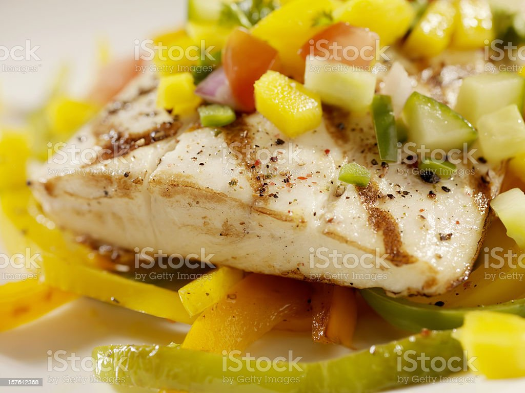 Grilled Halibut with Mango Salsa and Roasted Peppers royalty-free stock photo