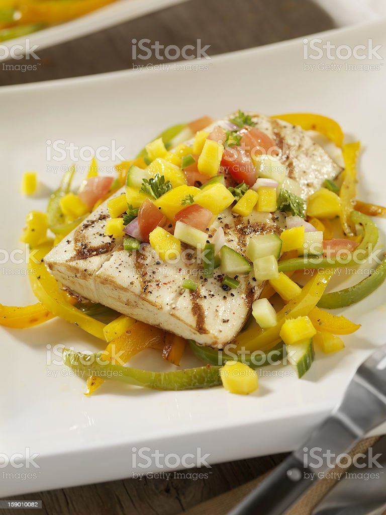 Grilled Halibut with Mango Salsa and Roasted Peppers stock photo