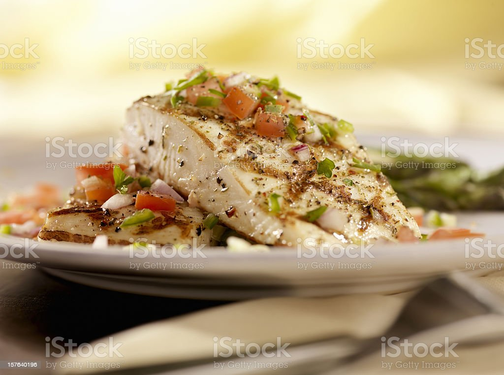Grilled Halibut with Salsa and Roasted Asparagus stock photo