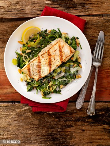 istock Grilled Halibut with Spinach, leeks and Pine Nuts 511940320