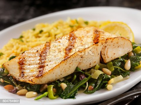 istock Grilled Halibut with Spinach, leeks and Rice 504754902