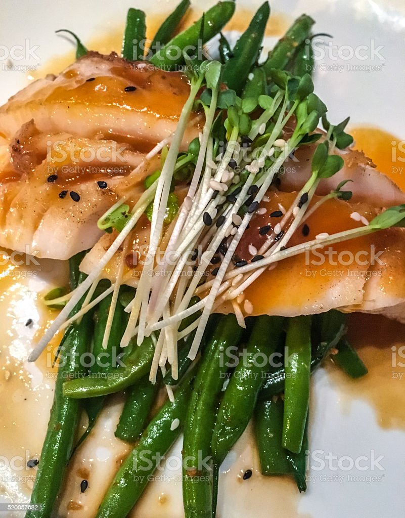 Grilled Halibut with vegetables stock photo