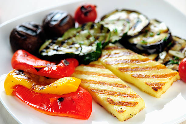 Grilled Halloumi cheese and vegetables stock photo