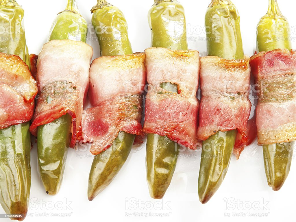 Grilled jalapenos wrapped in bacon royalty-free stock photo