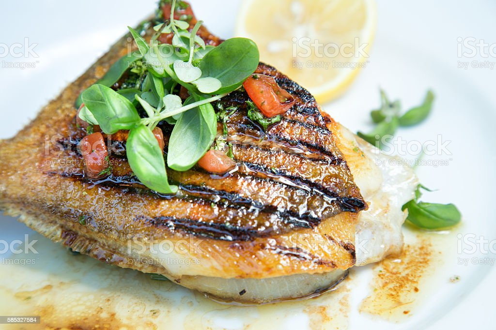 Grilled John Dory Fish Steak With Thyme And Lemon stock photo