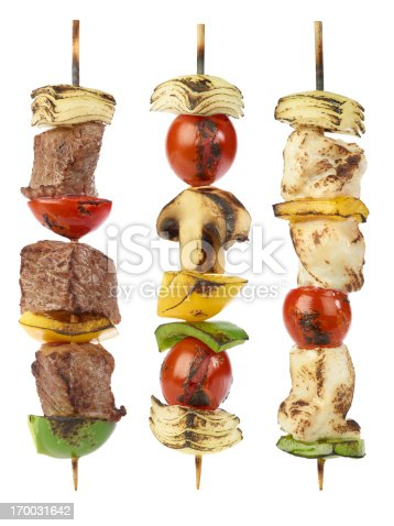 Grilled beef,, chicken and vegetable kebabs isolated on white