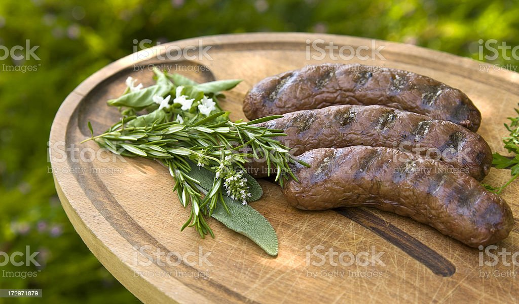 Grilled Lamb Breakfast Sausages & Fresh Herbs, Barbeque Hot Dogs royalty-free stock photo