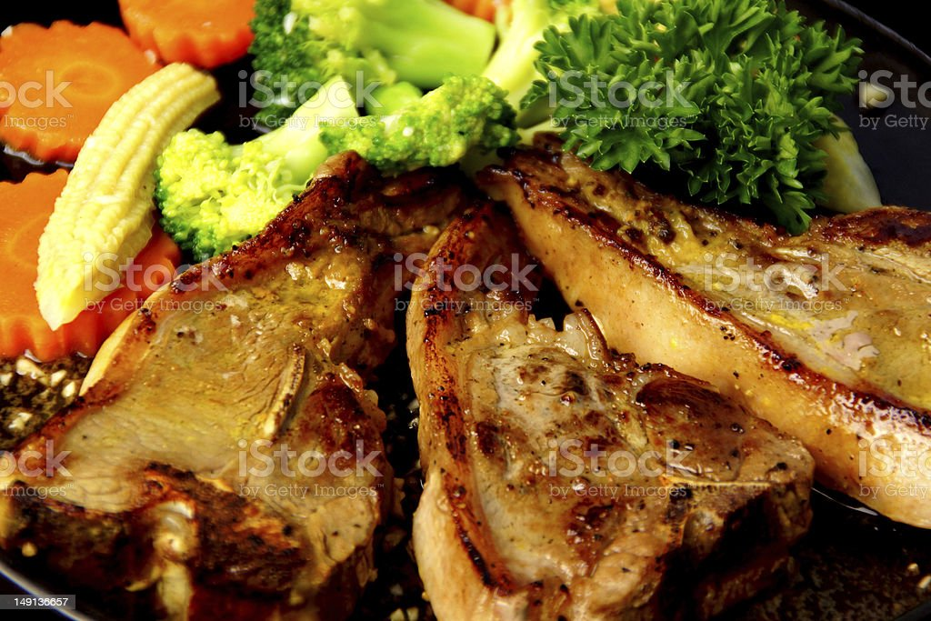 Grilled Lamb Chops Served with Mint Sauce royalty-free stock photo