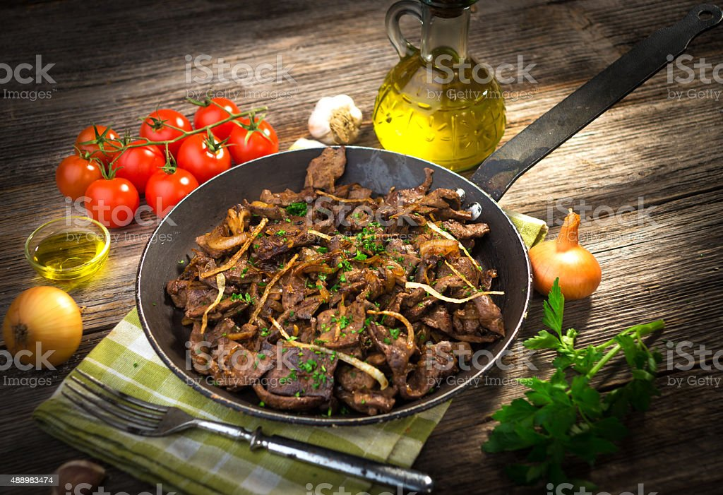 Grilled liver with onion stock photo