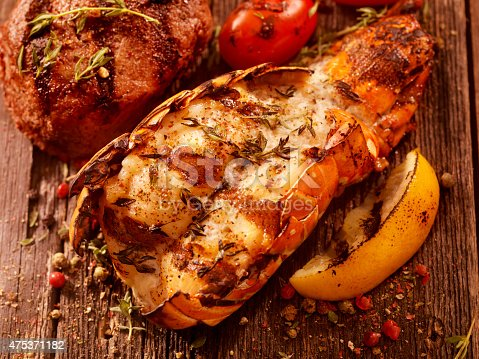 BBQ Grilled Lobster Tail and Steak Fillet with Fresh Herbs, Grilled Lemon and Tomatoes -Photographed on Hasselblad H3D2-39mb Camera