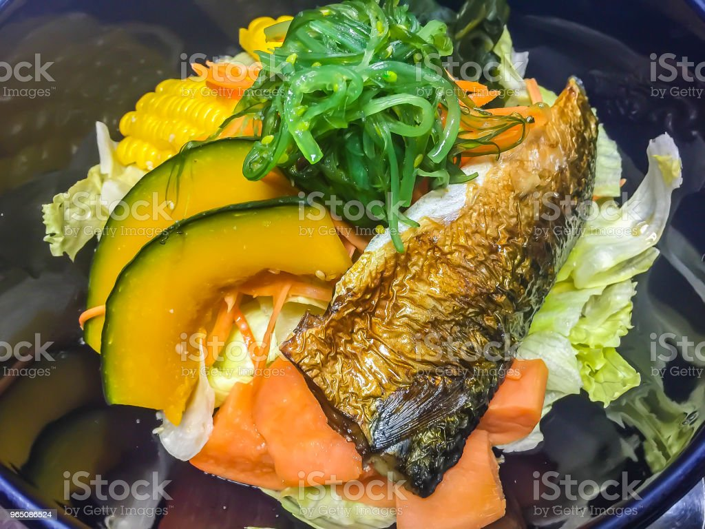 Grilled mackerel saba fish (Godeungeo saengsungui), Korean style food with pumpkin, corn, seaweed, carrot and cabbage in the bowl for lunch in the Korean restaurant. zbiór zdjęć royalty-free