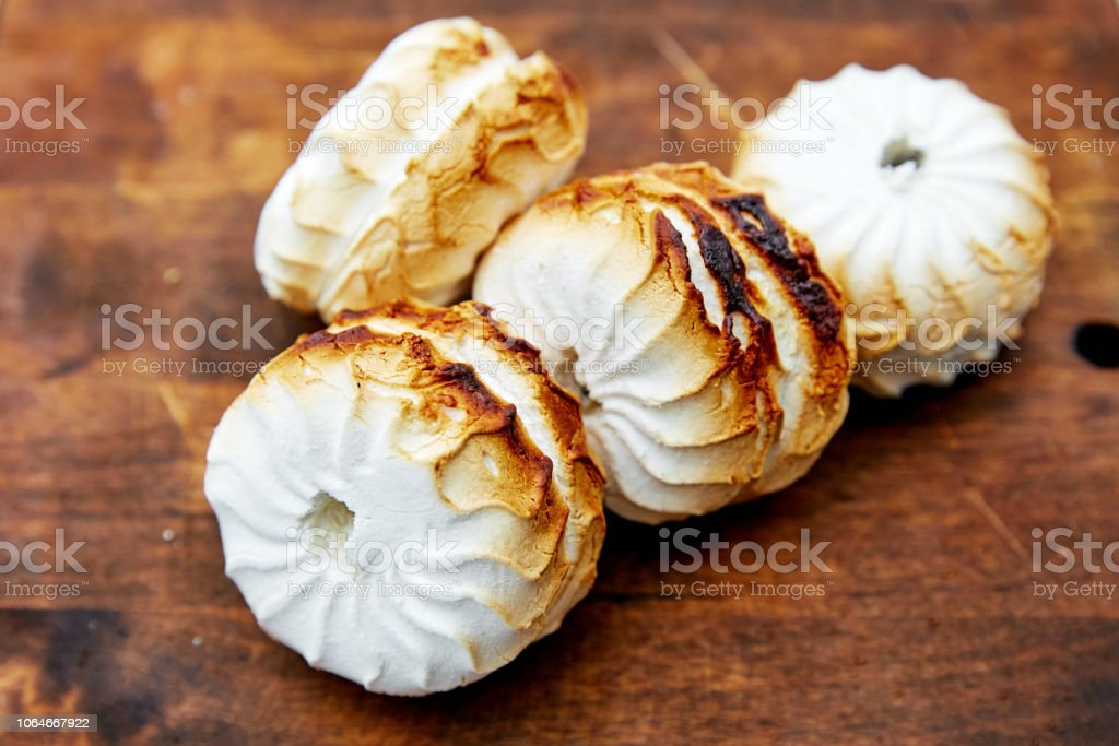 grilled marshmallows on the wood stock photo