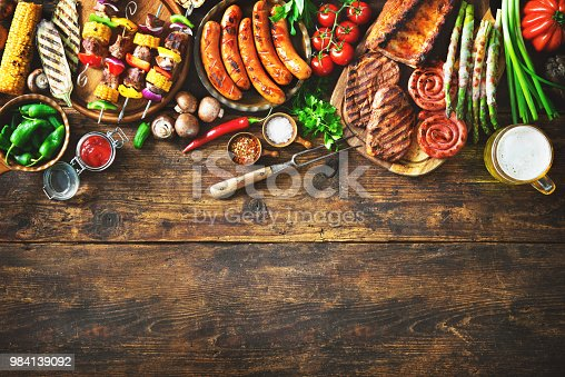 istock Grilled meat and vegetables on rustic wooden table 984139092