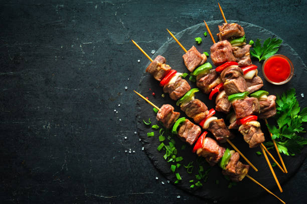 Grilled meat and vegetables on skewers stock photo