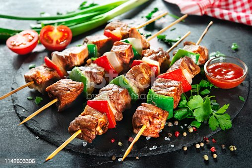 655794674 istock photo Grilled meat and vegetables on skewers 1142603306