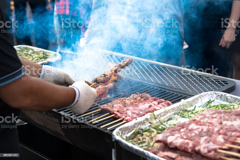 Grilled meat at street food market stock photo
