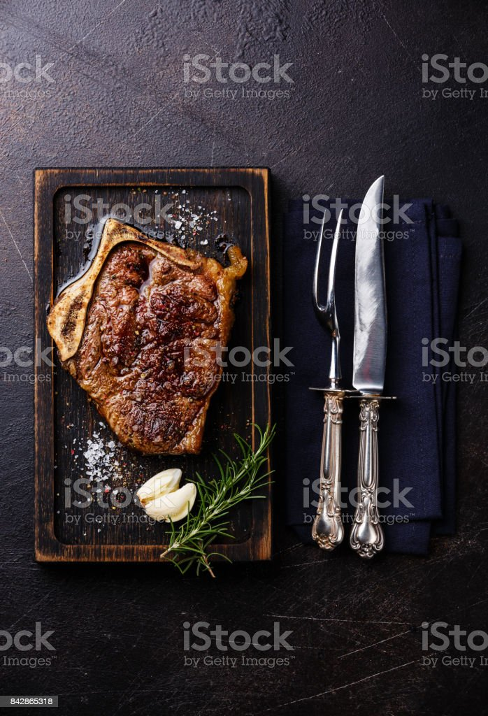 Grilled meat barbecue steak Blade on bone and carving set stock photo
