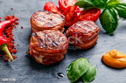 istock Grilled meat fillet steak wrapped in bacon medallions 539813780