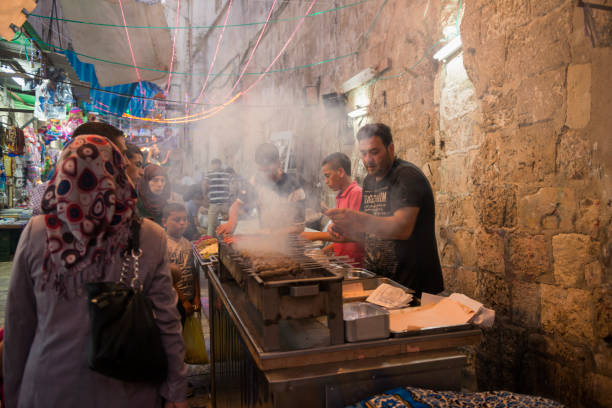 Grilled meat for iftar meal in Jerusalem's Muslim Quarter In the final half-hour before sunset, Palestinians in the Muslim Quarter of Jerusalem's Old City purchase grilled meat and other food with which they will break the Ramadan fast. muslim quarter stock pictures, royalty-free photos & images