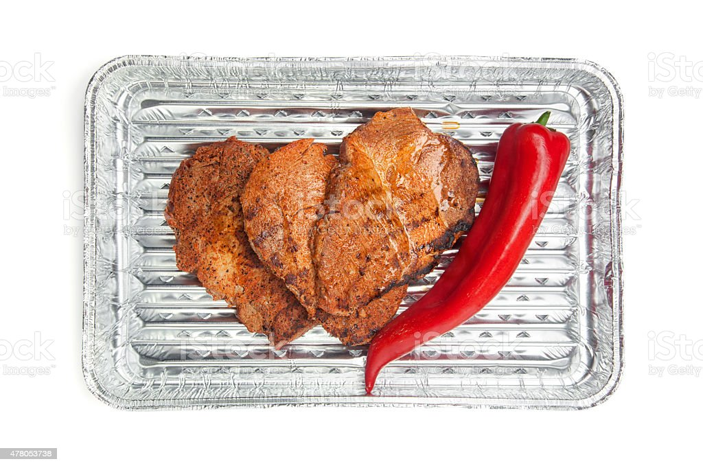 Grilled meat in barbecue tray stock photo