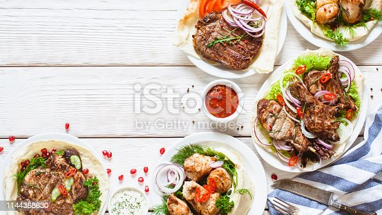 646207652istockphoto grilled meat meals food table barbecue table dish 1144368630