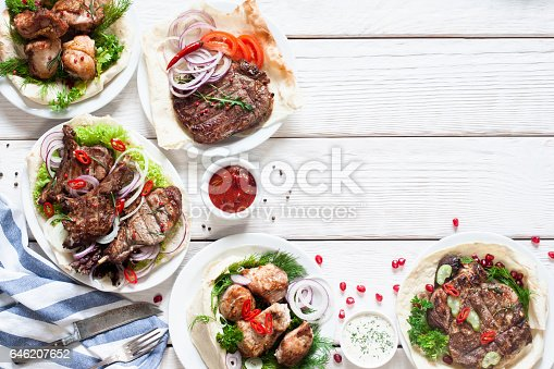 istock Grilled meat meals on table free space 646207652